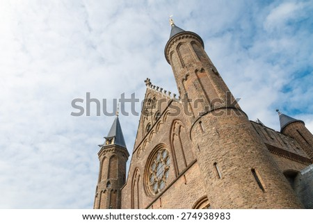 Oblique view of the facade of the large Gothic Hall of Knights (Ridderzaal) in The Hague, Netherlands - stock photo
