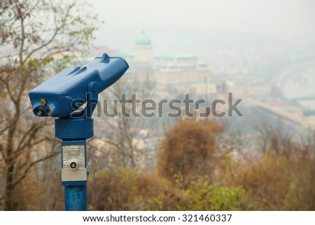 Observation deck. Binoculars. Observation deck with binoculars, view of Budapest city, Hungary. View of the other side of the Danube in Budapest. Foggy weather. - stock photo