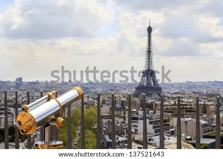 Observation telescope pointed to Eiffel tower / view from the rooftop of the Arc de triomphe, Paris, France - stock photo