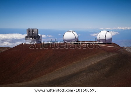 Observatory dome at the peak of Mauna Kea volcano, Hawaii. Telescope structure on volcano top above the main cloud layert. - stock photo