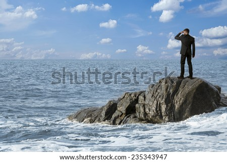 Observing man on rocks in the sea, montage - stock photo