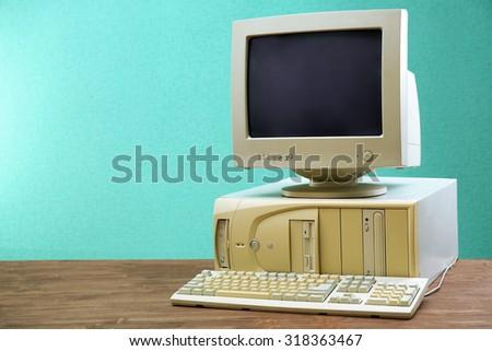 Obsolete computer set on light blue background - stock photo