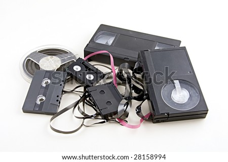 Obsolete magnetic tape formats in a trash pile with all logos and trademarks removed - stock photo