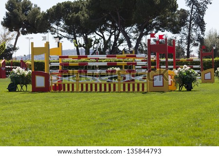 Obstacles in a competition of horse jumps - stock photo