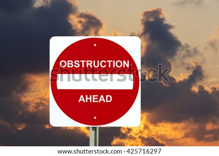 Obstruction sign over stormy clouds - stock photo