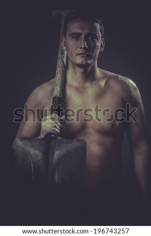 Occupation, Male worker holding a shovel, sexy builder - stock photo