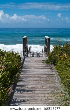 Ocean access boardwalk to Florida Beach, Vertical format - stock photo