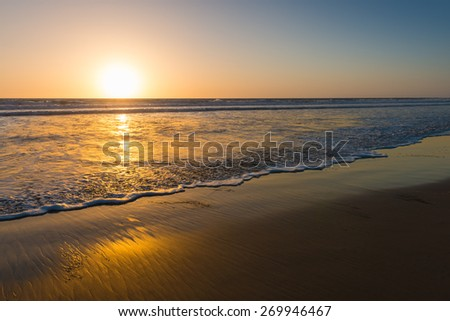 Ocean and beach at sunset. California Coast - stock photo
