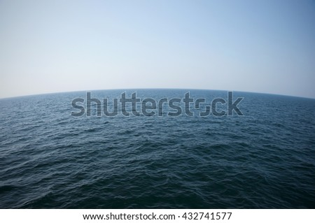 Ocean and curved horizon - stock photo