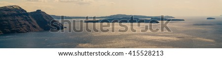 ocean and island in fog - stock photo