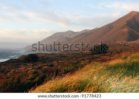 Ocean and Mountain landscape along Big Sur coastline south of Monterey, California. - stock photo