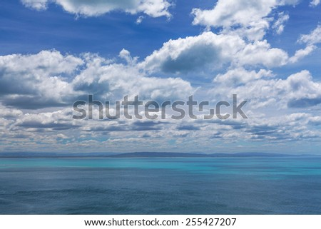Ocean and Sky postcard view from Otago, South Island, New Zealand - stock photo