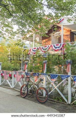 OCEAN BEACH, FIRE ISLAND, US, JULY 6, 2016: House decorated with American flags for Independence Day - stock photo