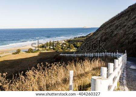 Ocean Beach/ Hawkes Bay, New Zealand. The road leading down into one of the Hawkes Bay's most iconic beach towns  - stock photo