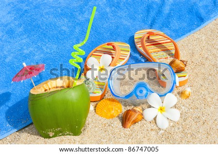 Ocean beach with diving mask and coctail - stock photo