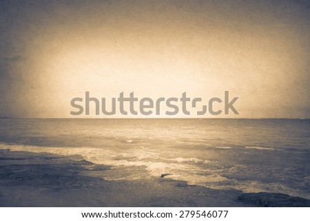 Ocean beach with parchment texture effect - stock photo