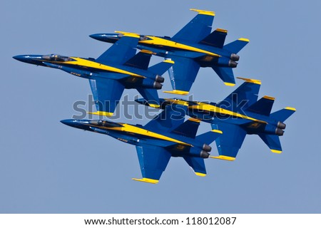 OCEAN CITY - JUNE 9:US Navy Blue Angels performing demo routine flying special painted f-18 Hornets on June 9, 2012 in Ocean City, Maryland. Blue Angels are the oldest demonstration team in the world - stock photo