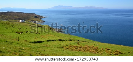 Ocean, islands and cottage in Scotland - stock photo