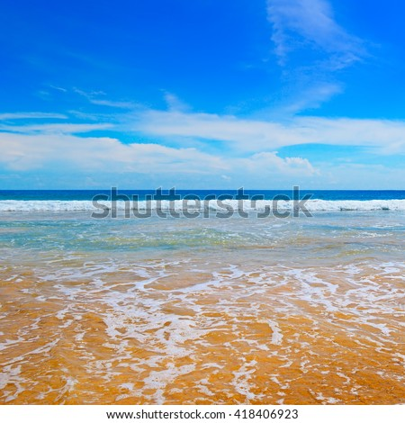ocean, picturesque beach and blue sky - stock photo