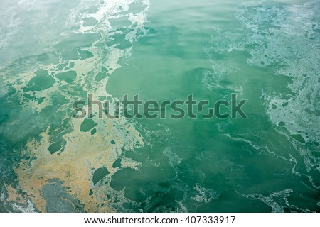 Ocean pollution  Fuel oil creates an oil slick that floats on top of ocean waters and contaminates the environment - stock photo