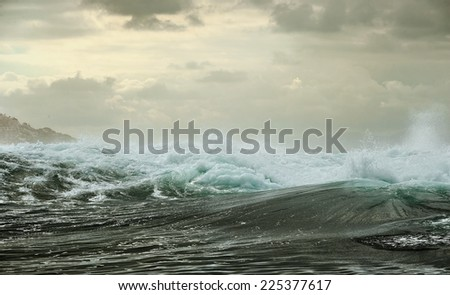 Ocean storm. Wave on the surface of the ocean. Wave breaks on a shallow bank  - stock photo