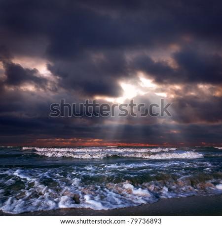 Ocean storm with sun beam - stock photo