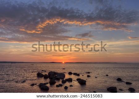 Ocean sunset in Newfoundland, Canada. - stock photo