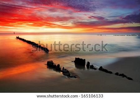 Ocean sunset on beach - Poland - stock photo
