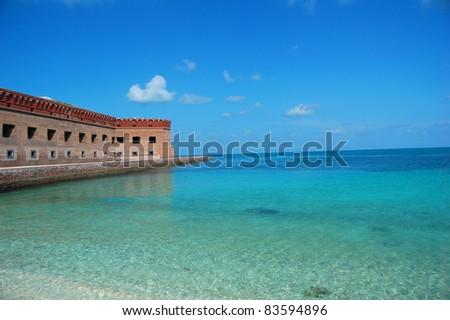 ocean surrounding fort jefferson on garden key, dry tortugas, florida - stock photo