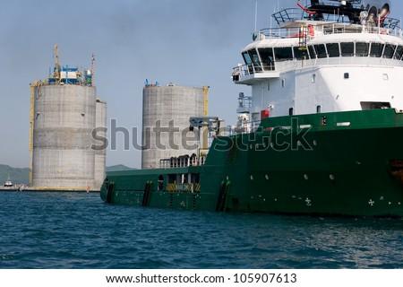 Ocean tug towing the base oil drilling platform. Sea Japan. Russian coast. - stock photo