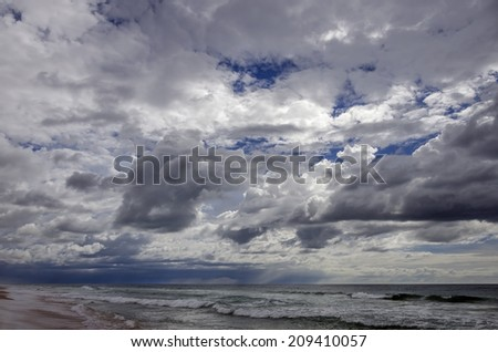 Ocean under dramatic sunset sky. Amazing cloudscape - stock photo