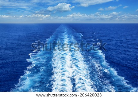 Ocean wake from cruise ship, on bright summer day. - stock photo