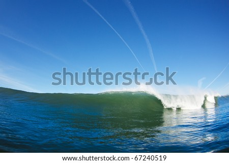 Ocean Wave and Blue Sky, View from Water Level - stock photo