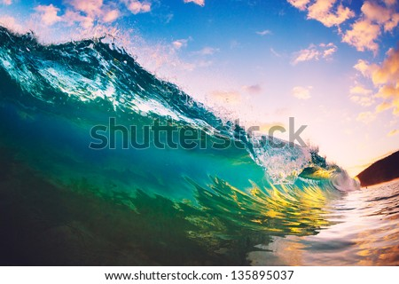 Ocean Wave at Sunset - stock photo