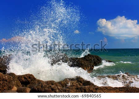 Ocean wave breaking on the sea shore - stock photo