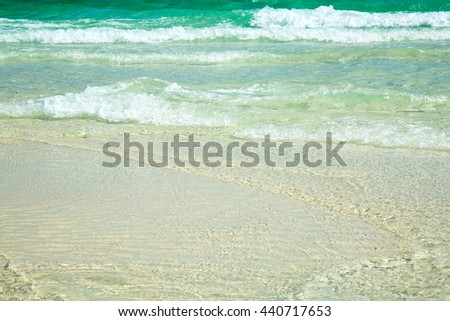 Ocean wave/Rolling Waves/The tide is coming in off the Florida coast, where the water is clear and emerald colored.  - stock photo