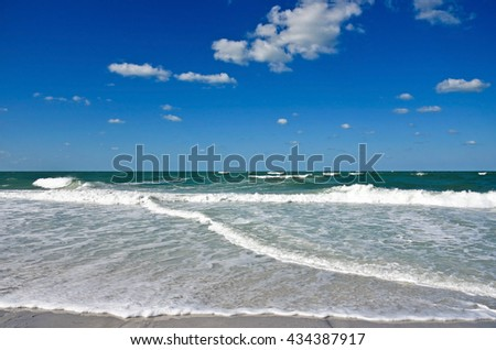 Ocean Waves and Surf on the Sandy Beaches of Anna Maria Island - stock photo