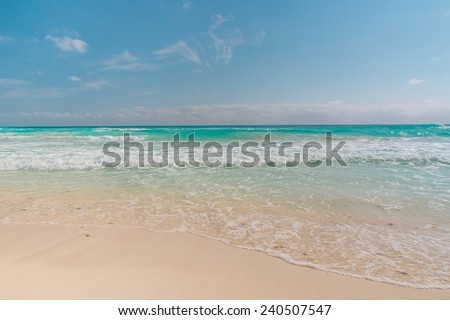 Ocean waves, white sand beach, Caribbean sea - stock photo