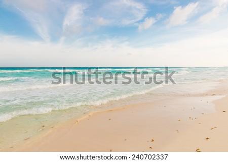 Ocean waves, white sand beach, Caribbean sea, Cancun, Mexico. - stock photo