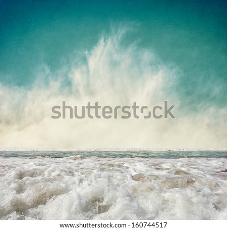 Ocean waves with fog rising at the horizon.  Image displays a pleasing grain texture at 100 percent. - stock photo