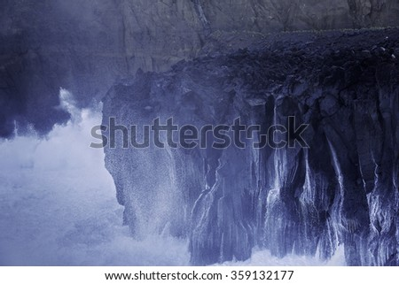 Ocean waves with splash break on volcanic cliffs, Azores - stock photo