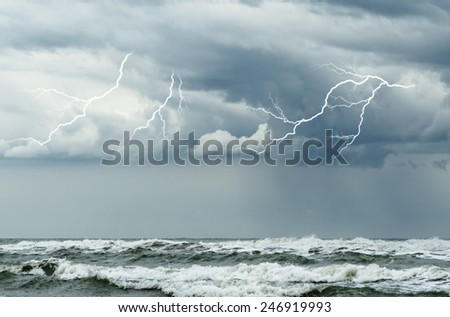 ocean with big waves and lightning - stock photo