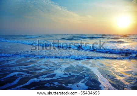 Ocean with waves during sunset. Natural darkness and colors - stock photo