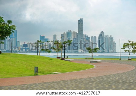 Oceanfront walkway in Panama City with skyscrapers and cloudy sky, Panama, Central America - stock photo