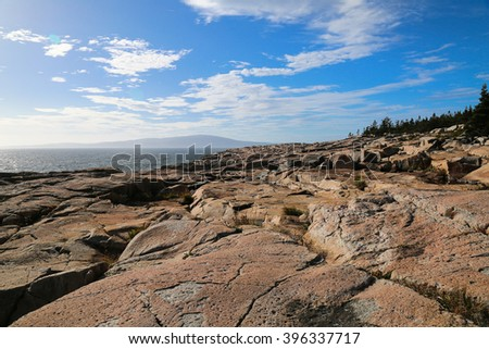 Oceanside/Rocky Shore/Walking along the rocky shore of Maine on a clear and sunny summer day.  - stock photo