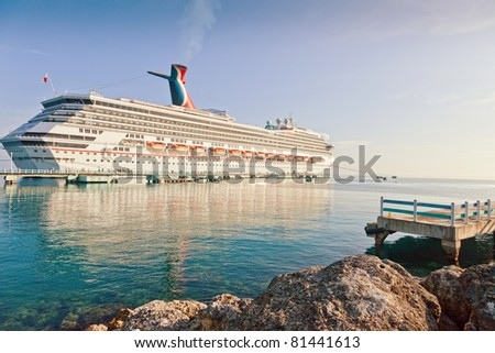 OCHO RIOS, JAMAICA - JULY 14:  Carnival cruise ship docks in Ocho Rios, Jamaica on July 14, 2011, once the most famous Jamaican port, is now losing popularity to the newest port located in Falmouth. - stock photo