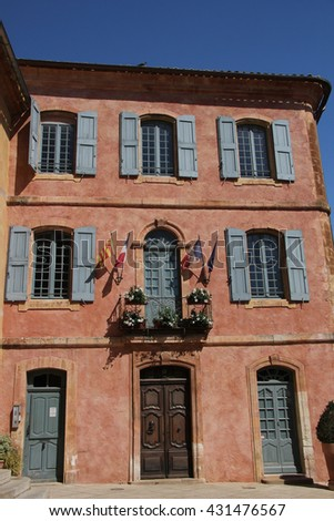 Ochre facade of The town hall in Roussillon, Provence - stock photo