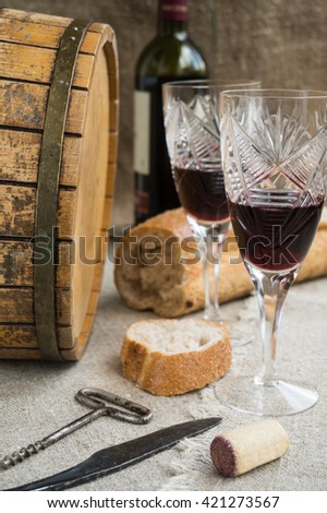 Octave, bread and two wineglasses are on sacking - stock photo