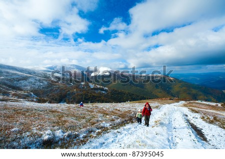 October Carpathian mountain Borghava plateau with first winter snow (and mother with children) - stock photo