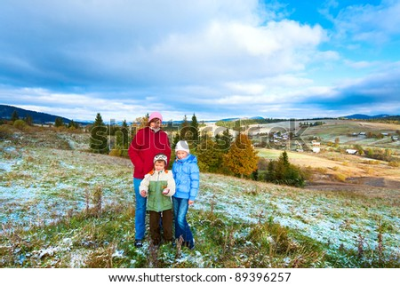 October Carpathian mountain plateau with first winter snow and autumn colorful foliage (and mother with children) - stock photo